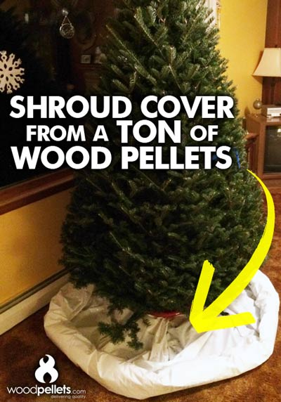 Use the shroud cover from your ton of wood pellets as a Christmas tree clean-up tool!